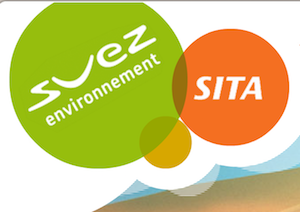 green and orange logo with atop sand back ground