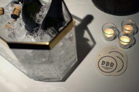 champagne on ice glass jar