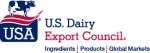 A cow sitting on top of USA diary Logo