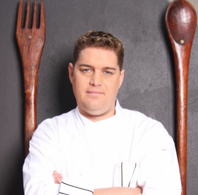 chef stephen billigham headshot with arms folded
