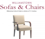 cream chair with brown arm rests