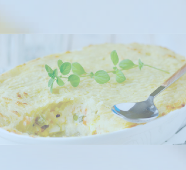 Dish of fish pie with sprig of corriander on it